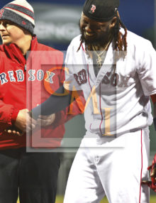 Red Sox Hanley Ramirez grimaces in pain after being stuck by a pitch
