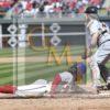 Phillies center fielder Obubel Hernandez slides home safely on a double