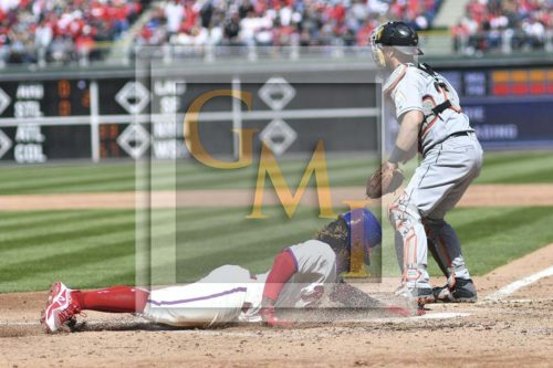 Phillies center fielder Obubel Hernandez slides home safely on a double
