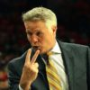 Philadelphia 76ers head coach Brett Brown flashes a victory sign