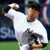 Yankees starting pitcher Masahiro Tanaka throws a strike