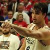Philadelphia 76ers forward Dario Saric points the way