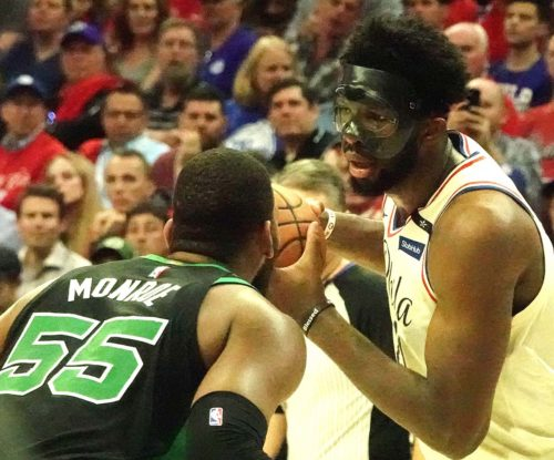 Philadelphia 76ers center Joel Embiid looks into the face of Boston Celtics Greg Monroe