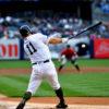 Yankees center fielder Brett Gardner singles in the first