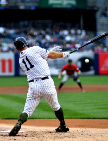 Yankees center fielder Brett Gardner singles in the first