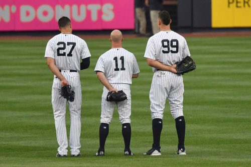 Yankees outfielders stand tall