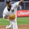 Yankees CC Sabathia throws a strike to Boston Red Sox short stop Xander Bogaerts
