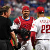 Phillies catcher Jorge Alfaro flashes a smile to Phillies manager Gabe Kapler