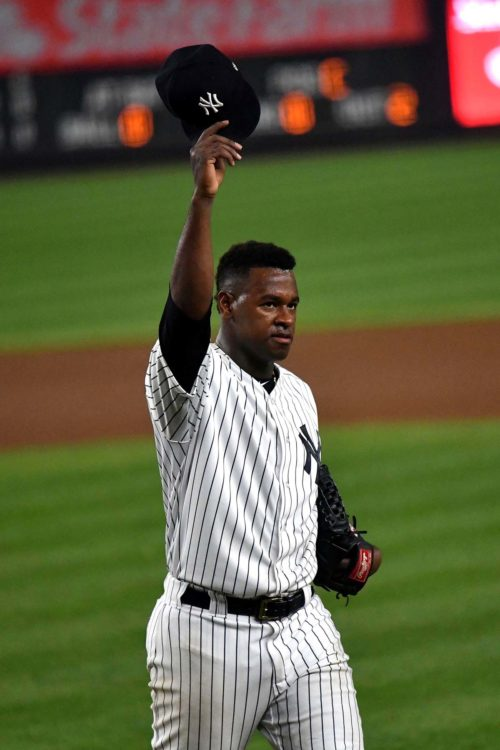 Yankees starting pitcher Luis Severino walks off the field to a standing ovation
