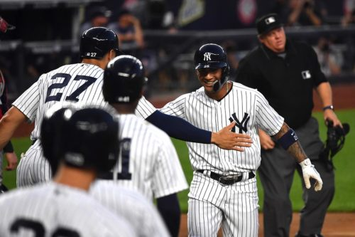 Yankees Glyber Torres congratulated by his teammates after hitting his major league leading sixth 3-run home run