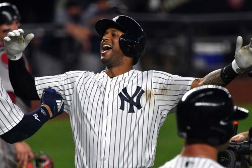 Yankees leadoff hitter AARON HICKS celbrates hitting his first of three home runs
