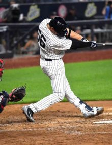 Yankees third string catcher KYLE HIGASHIOKA homers into the second deck in left field