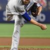 New York Mets starting pitcher Jacob deGrom strikes out Yankees Austin Romine
