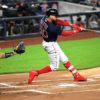 Boston Red Sox leadoff batter Mookie Betts doubles in the first inning