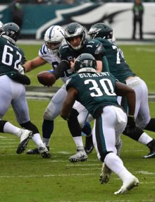 Eagles quarterback Carson Wentz hands off to Corey Clement