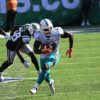 Miami Dolphins running back Frank Gore gains 19 yards