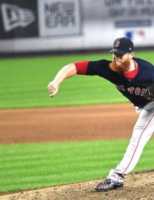 Boston Red Sox closer Craig Kimbrel strikes out New York Yankees designated hitter Giancarlo Stanton