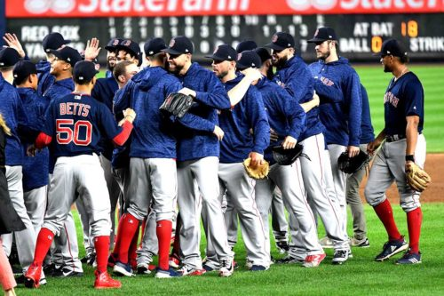 Boston Red Sox celebrate after defeating the New York Yankees 11-6