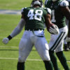 New York Jets linebacker Jordan Jenkins celebrates forcing and recovering a fumble