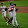 Boston Red Sox catcher Christian Vasquez hugs Red Sox closer Keith Kimbral
