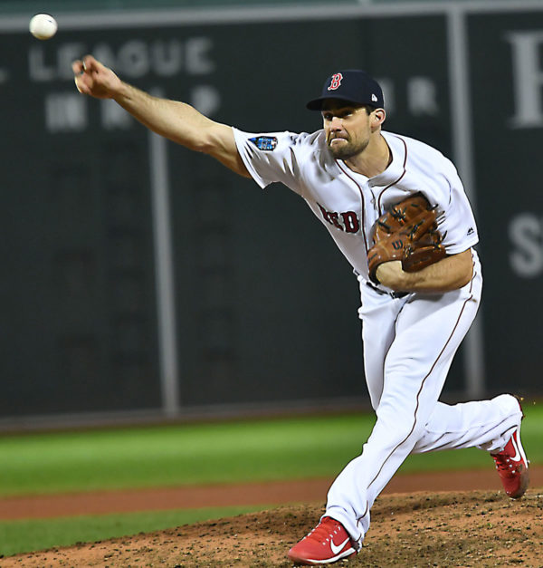 Red Sox reliever Nathan Eovaldi throws a strike to Dodgers Yasiel Puig