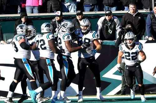 Panthers tight end Greg Olson is congratulated by his teammates