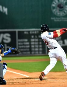 Red Sox left fielder ANDREW BENINTENDI hits an RBI double