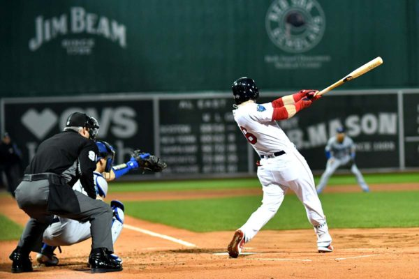 Red Sox left fielder ANDREW BENINTENDI hits an RBI double