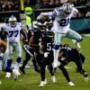 Dallas Cowboys running back Ezekiel Elliot leaps over Eagles safety Tre Sullivan for a first down