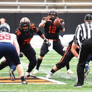 Princeton University star quarterback John Lovett takes the ball