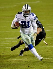 Dallas Cowboys running back Ezekiel Elliot runs for a first down