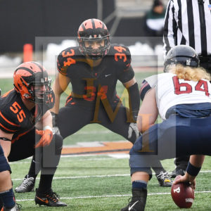 Princeton Uniiversity middle linebacker, TOM JOHNSON, focusses on the Penn quarterback in the first quarter of the game. JOHNSON, Princeton's leading tackler leads his team to their first indefeated season since 1964.