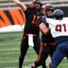 Princeton University quarterback John Lovett throws a touchdown pass