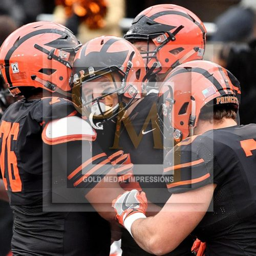 Princeton University leading receiver, JESPER HORSTED(CENTER), is hugged by his teammates after scoring his fourth touchdown of the game in the third quarter against Penn. HORSTED, who has received more passes than any player in Princeton History, led his team to a 42-14 victory and Princeton's first undefeated season in 54 years.