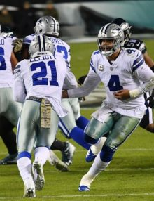 Dallas Cowboys running back Ezekiel Elliot takes a hand-off from quarterback Dak Prescott