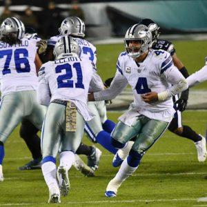 Dallas Cowboys running back Ezekiel Elliot takes a hand-off from quarterback Dak Prescott