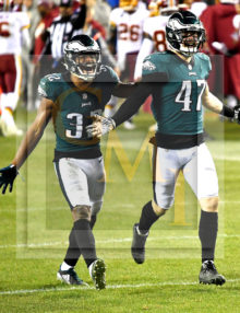 Eagles cornerback Rasul Douglas and outside linebacker Nathan Gerry celebrate interception