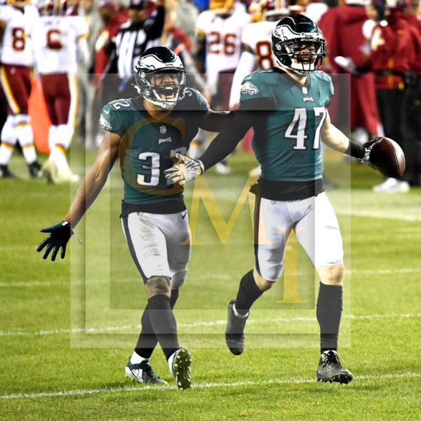Eagles cornerback Rasul Douglas and outside linebacker Nathan Gerry celebrate interception