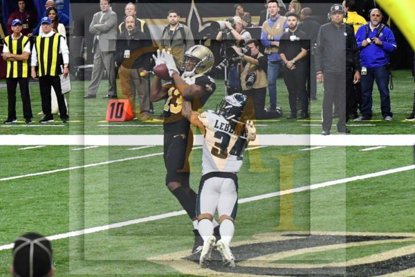 Saints wide receiver Michael Thomas receives the go-ahead touchdown pass from quarterback Drew Brees