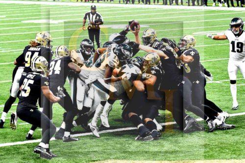 Eagles quarterback Nick Foles reaches for a touchdown against the New Orleans Saints