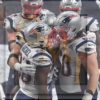 New England Patriots running back Sony Michel is congratulated by David Andrews