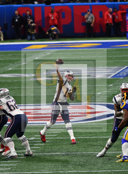 Tom Brady throwing a pass at Super Bowl LIII