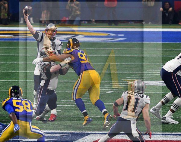 New England Patriots quarterback Tom Brady completes a pass to his wide receiver Julian Edelman