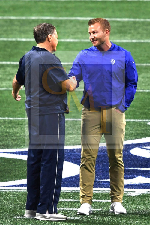 The youngest Super Bowl head coach SEAN McVAY of the Los Angeles Rams shakes hands with the oldest head Coach BILL BELICHICK