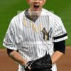 New York Yankees James Paxton celebrates striking out the side in the seventh inning