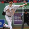 Boston Red Sox starting pitcher Chris Sale gives up a leadoff single