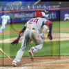 Philadelphia Phillies outfielder Roman Quinn lays down a perfect RBI bunt single