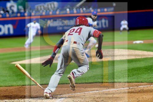 Philadelphia Phillies outfielder Roman Quinn lays down a perfect RBI bunt single