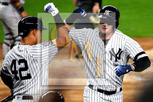 New York Yankees designated hitter Clint Frazier celebrates hitting a home run