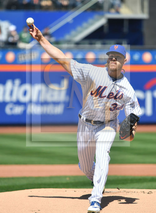 New York Mets starting pitcher, Noah Sydergaard throws the first pitch of the game